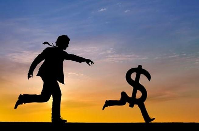 man-chasing-money